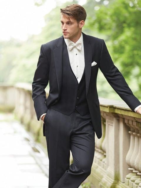 Three-piece men's suit in black.