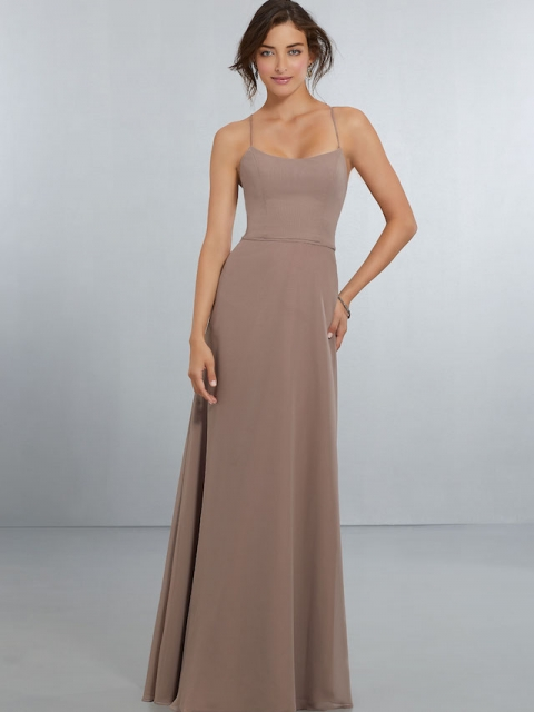 Mori Lee bridesmaid dress style number 21559. A-Line Chiffon Gown with Spaghetti Straps That Criss-Cross Across the Back and Tie into a Stylish Bow. Scoop Front and Back Neckline with Back Zipper. Shown in Fawn.