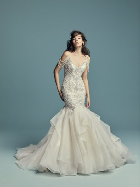 beaded fit and flare Maggie Sottero wedding dress with organza ruffle skirt and cold shoulder beaded strap under $2800